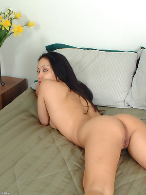 Beautiful Asian girl Milla freeing juicy ass and bush from white shorts
