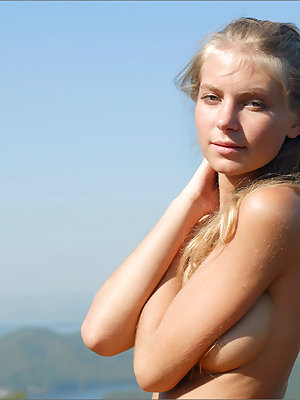 Young girl with puffy nipples spread wide open to sun naked on the rocks