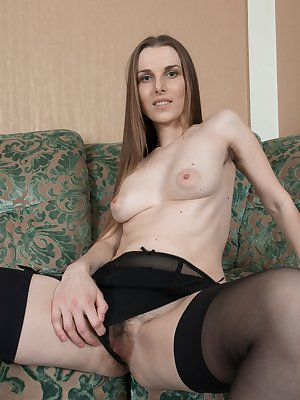 In a red dress, Donatella is ravishing and sexy. In her black panties and stockings, she is even more elegant. She strips them off while showing her hairy pits and hairy pussy and poses on her couch.