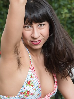Vivi Marie is relaxing on her chaise lounge in her bikini. She strips nude, and we see her hairy pits and very hairy pussy. She touches her sensual body all over, and looks wonderful outdoors naked.