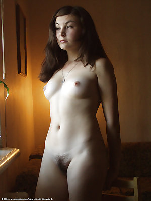 Horny young amateur babe Katta taking off her clothes and posing