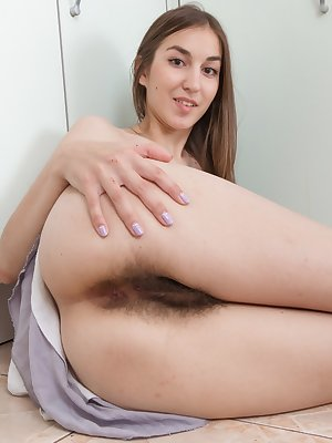 Amateur model Halmia displays her really hairy bush and underarms