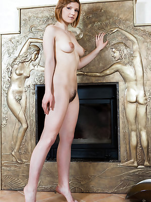 Hairy rich bitch Mariam spreading naked in front of the family fireplace