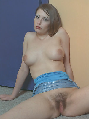 Amateur beauty Amanda is teasing her hairy pussy and big tits in a dress