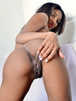 Black amateur Raven Wilde removes her bra and panty combo for nude poses