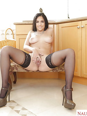 Brunette wife Annika Eve strips down to nylons to play with hairy Latina pussy