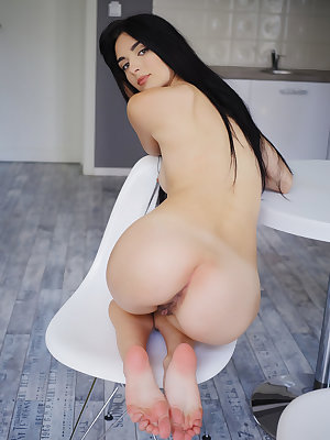 Luscious raven-haired model Benita spreads her long sexy legs