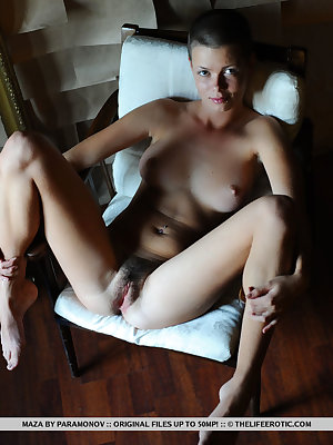 Leggy solo model shows off her trimmed bush in a buzz cut hairstyle
