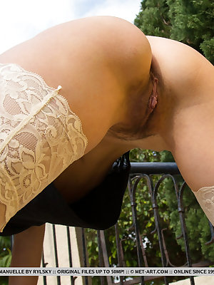 Stunning young Emanuelle displays her appealing pussy on the steps outdoors