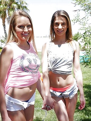 Teen lesbians Scarlett Sage and Kristen Scott get naked to walk down sidewalk