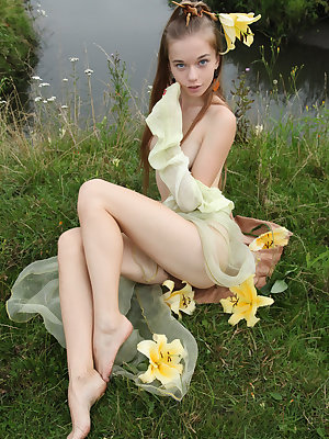 Young teen Milena D naked outdoors showing perky small tits & hairy muff