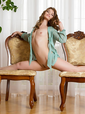 Bare assed Nedda indulges her nude fantasies with naked stretches while alone