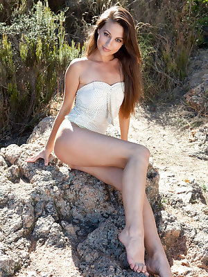 Erotic girl Lorena B flaunting small boobs & hairy muff in bare feet outdoors