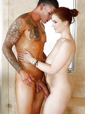 Curvy redheaded chick Siri jerking off long cock in bathtub