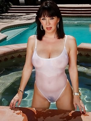 Hot MILF Ray Veness releases her big tits from her wet swimsuit
