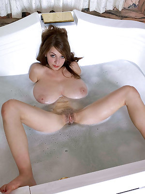 Solo model Merilyn Sakova plays with her hooters while taking a bubble bath