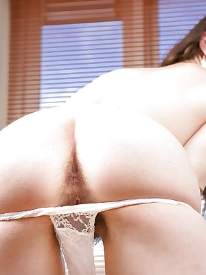 Glasses wearing amateur Emilia inserting hair brush into wet and hairy bush
