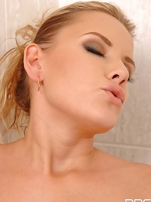 Solo girl Regina wets and fingers her all natural pussy in the shower
