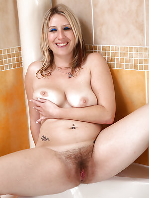 Appealing girl Mel Harper spreading legs to stretch her hairy beaver