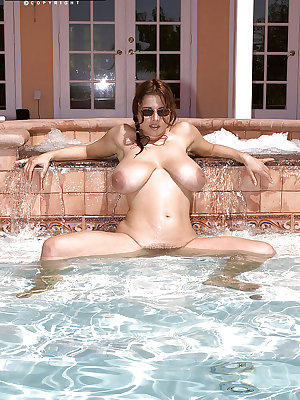 Big ass European babe Chloe Vevrier squeezes her huge globes over pool