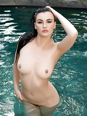 Super luscious centerfold Skylar Leigh gets naked for a solo near a pool