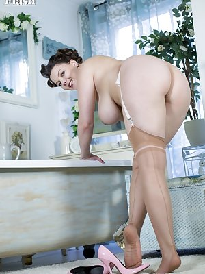 Big titted Victoria wets her hairy snatch and dons pantyhose to pose in heels