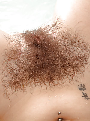 Older broad with furry legs loosing hairy vagina from swimsuit in bathtub
